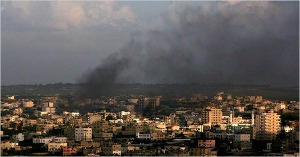 Smoke rises from Israeli missile strikes in Gaza City on Saturday. (Ali Ali/European Pressphoto Agency)