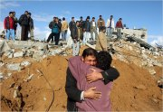 Palestinians searched for bodies in the rubble of a building after Israeli forces withdrew from the area east of Gaza City on Sunday. (Khalil Hamra/Associated Press)