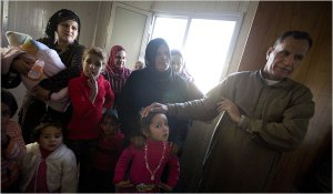 Ahmed Hassan Sharmal, right, and his extended family of 30, including three war widows, are forced to share only two trailers. (Johan Spanner for The New York Times)