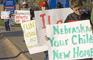 Protesters of Nebraska's safe-haven law hold signs in front of the Creighton University Medical Center