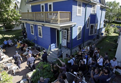 I-Witness Video members and friends in handcuffs during a police raid on their house in St. Paul, August 30, 2008. (AP: Matt Rourke)