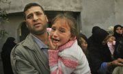 Relatives mourn a Palestinian man killed by Israeli soldiers in Gaza, last month. (Eyad Baba/AP)